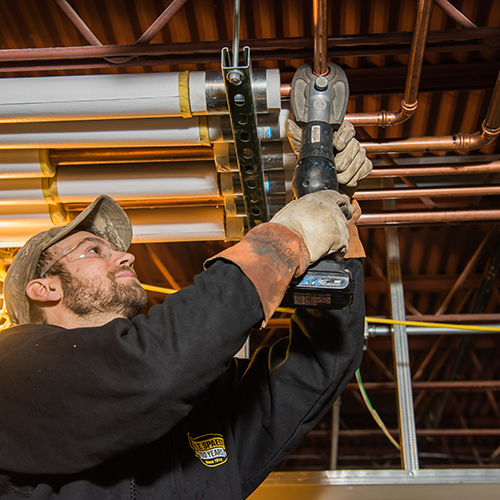 Wm.T. Spaeder plumber working on plumbing services for medical facility