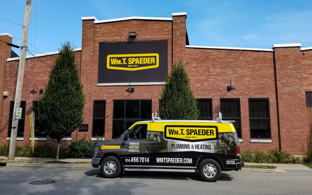 Wm. T. Spaeder main building with logo-wrapped van parked out front