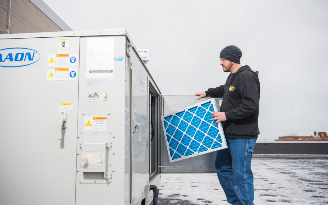 Spaeder Technician Changing Commercial HVAC Filter