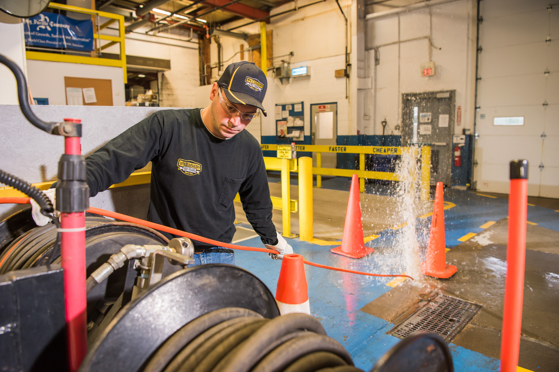 Spaeder Technician Cleaning Commercial Drain