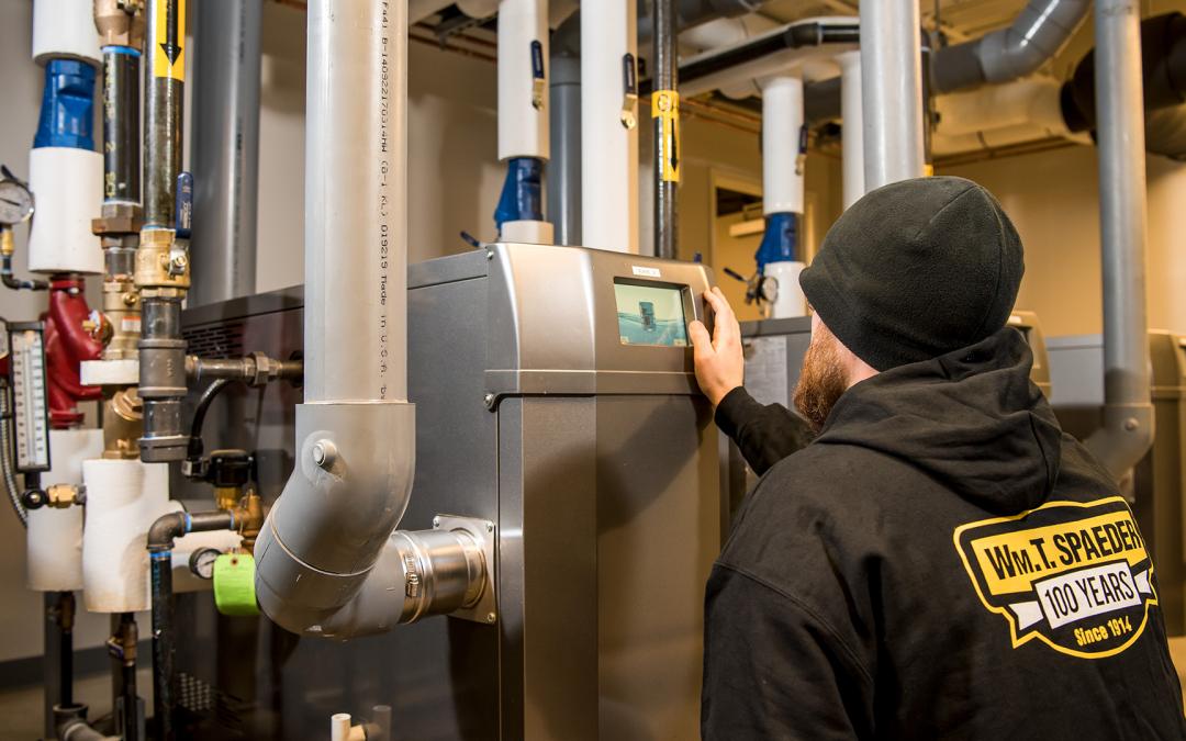 Spaeder Employee checking HVAC Equipment